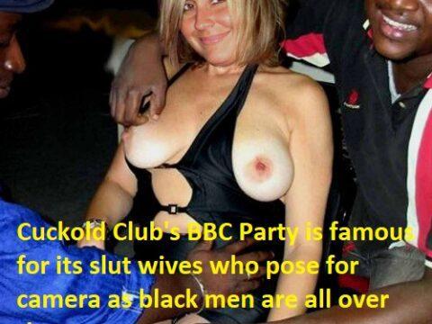 Slutwife-posing-for-camera-in-cuckold-club