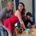 Cheating teen in red dress fucks a guy in front of her man